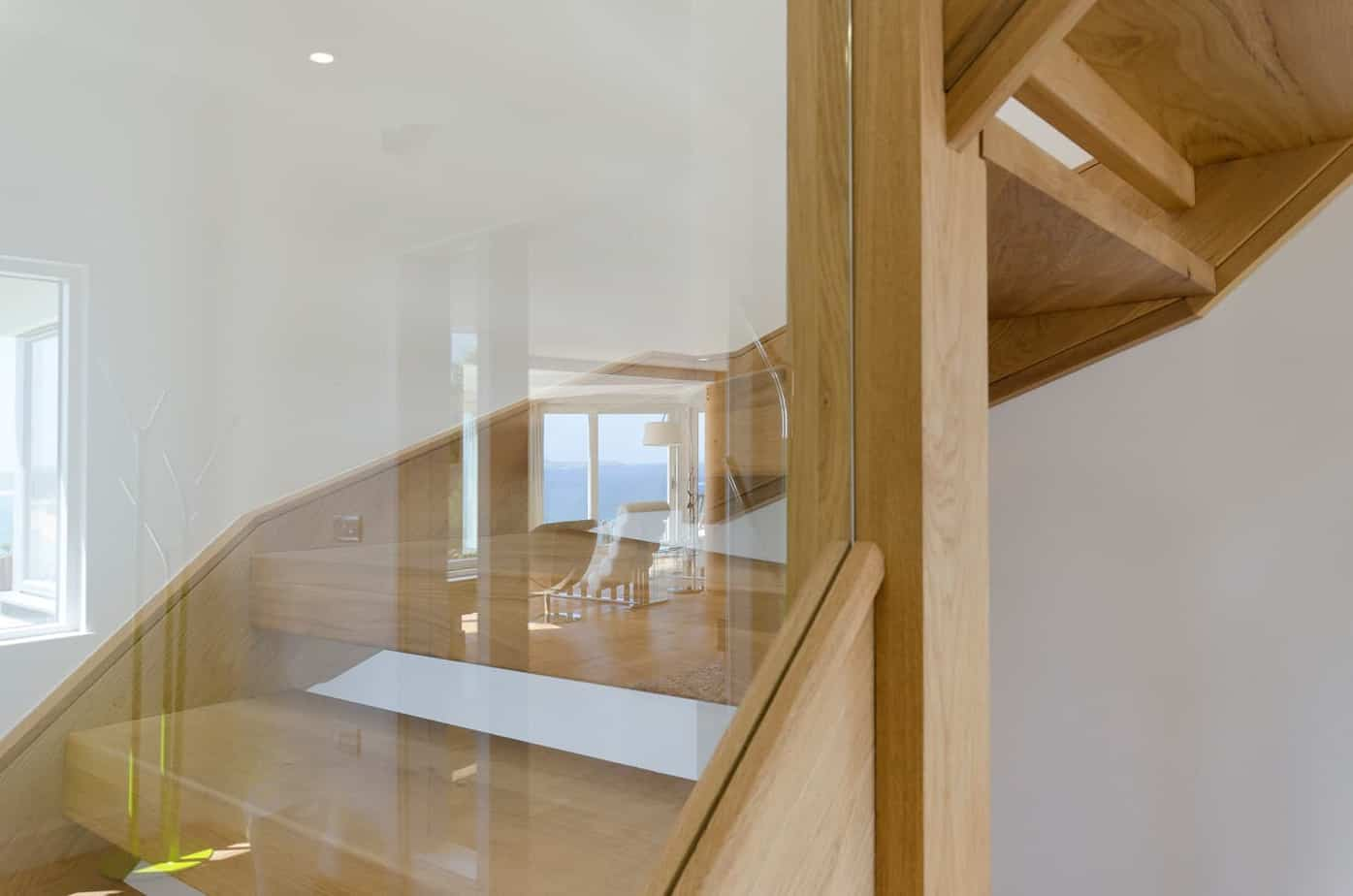 Glass banister and timber staircase