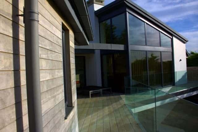 House with glass wall and balustrade