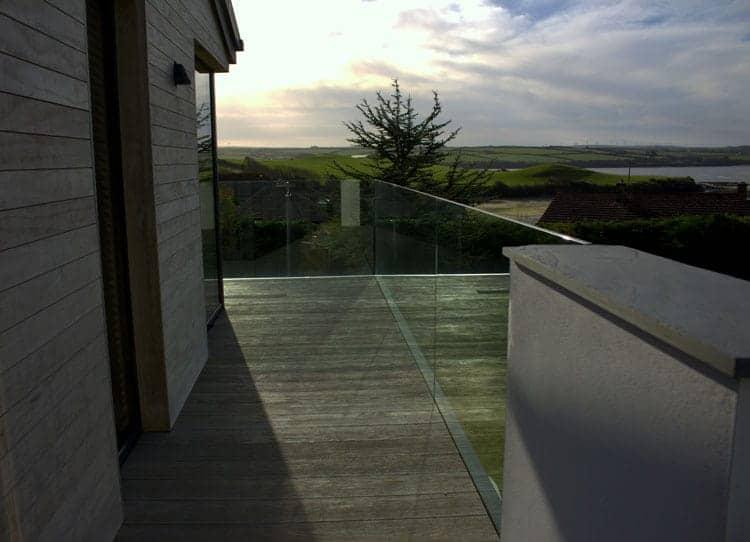 Frameless glass balustrade on decking