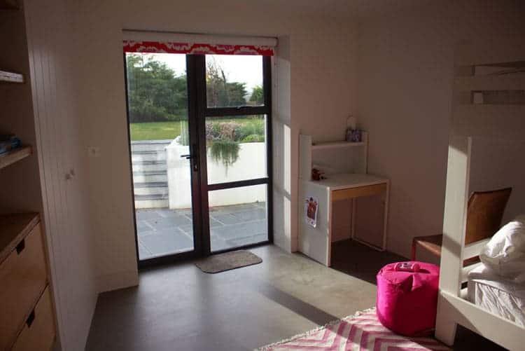 Bedroom with aluminium and glass door