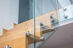 Point fixed glass on timber stairs