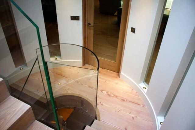 Curved timber and glass stairs