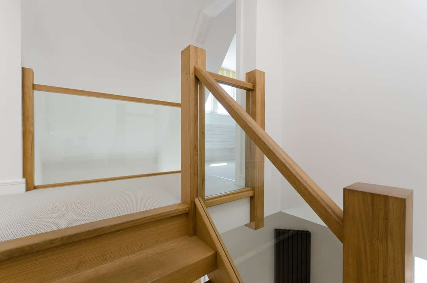 Top of timber stairs with glass panel