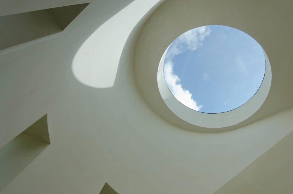 round glass window with view of sky