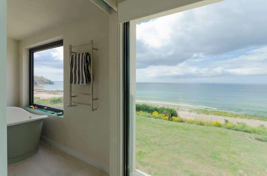opened aluminium door with sea view