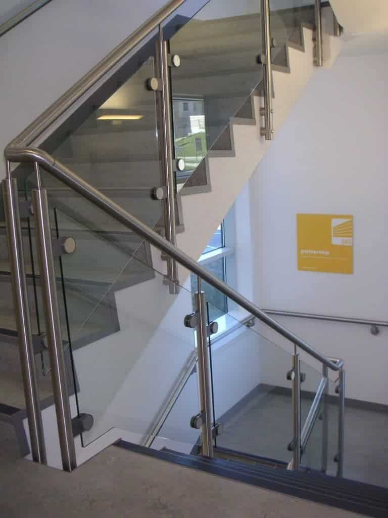 Post and rail glass balustrade for stairs