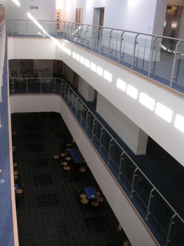 Large post and rail glass balustrade on corrdors