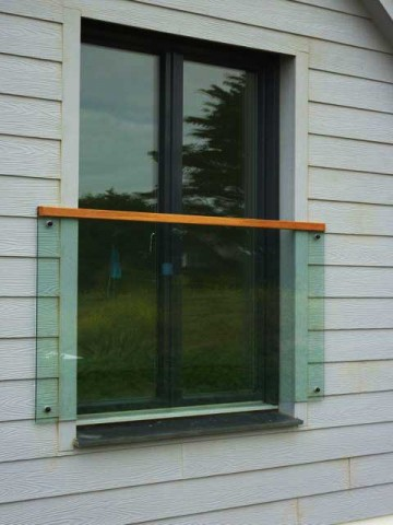 Glass Juliet balcony with timber rail