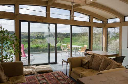 timber sunroom with sliding aluminium doors