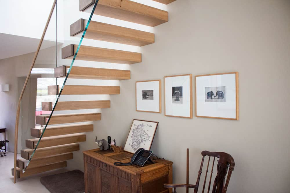 Oak & Glass Floating Staircase with Bronze tread ends & oak handrail