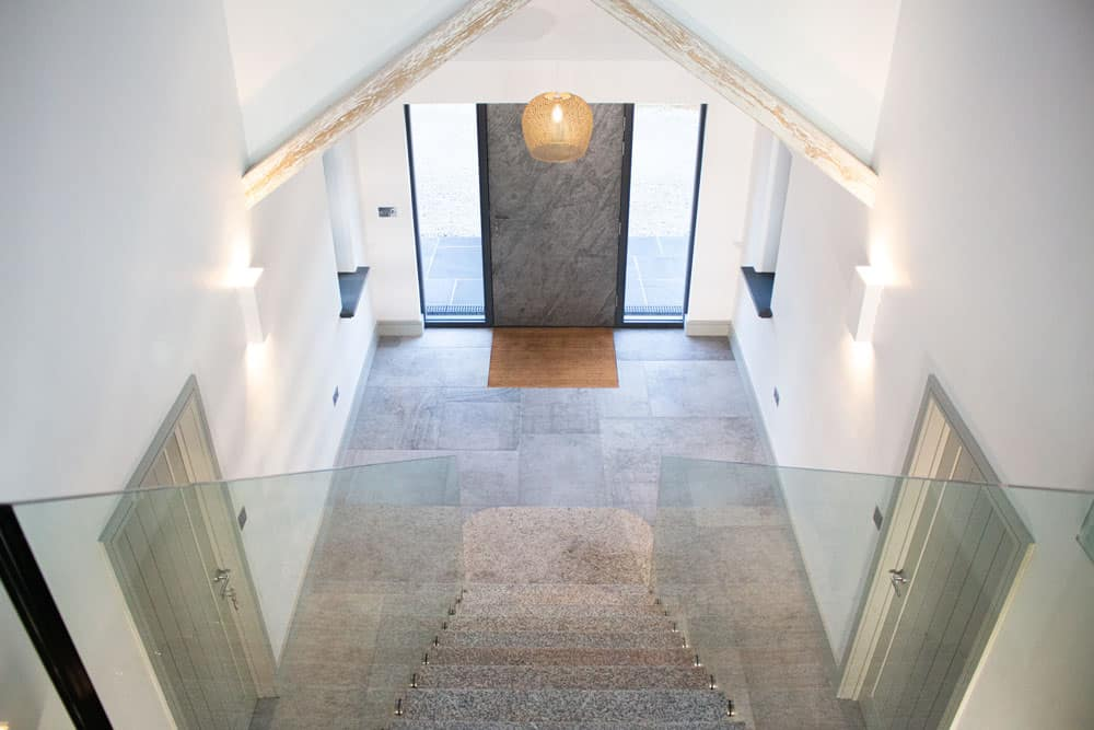 Granite & Glass staircase and stone door