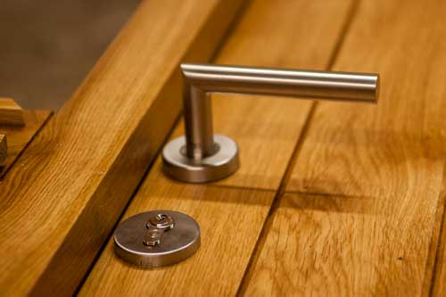Timber door with stainless steel handle
