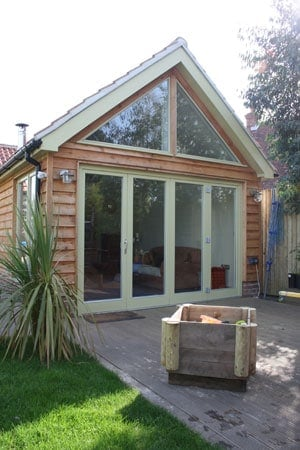 Green timber folding doors