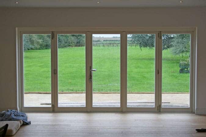 Timber folding doors in white