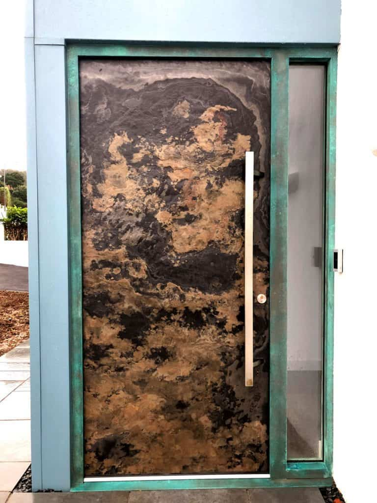 Stone door in a copper patina frame